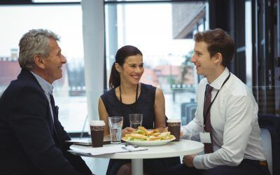 businesspeople-interacting-while-having-breakfast-YPDGQ56