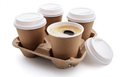 Coffee take out disposable cups wit lids in holder